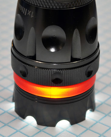 Nebo CSI Redline High Powered Flashlight Standing Up on Bezel
