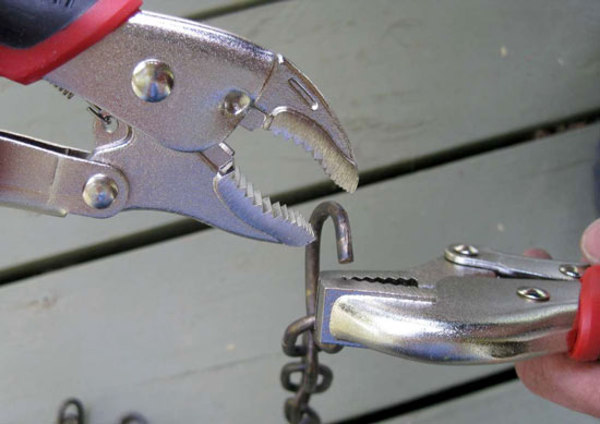 Blackhawk Locking Pliers Gripping Chain Links