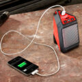 Milwaukee M12 Jobsite Speaker Charging Smartphone