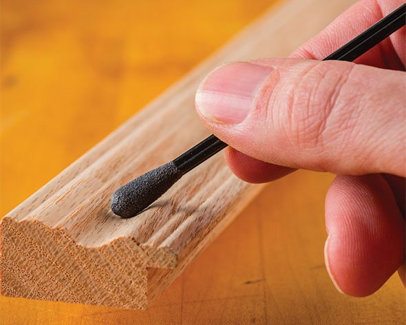 Sandits Sanding Stick Used on Wood Groove