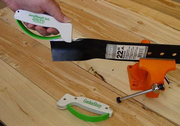GardenSharp from AccuSharp sharpening a lawnmower blade