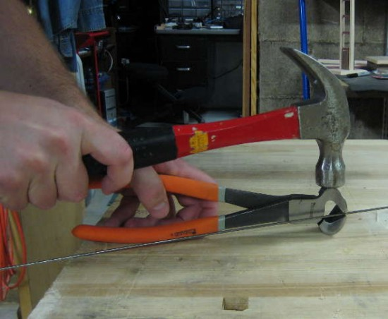 Hitting pliers with hammer
