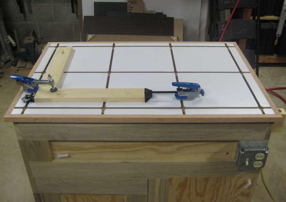 Clamping T-track table top holding pocket joinery