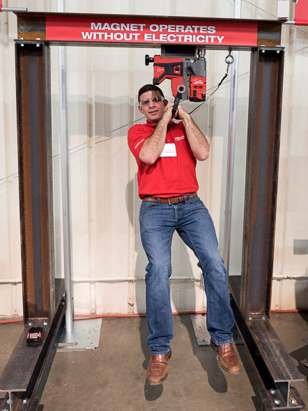 Milwaukee Product Manager Hanging from Steel I-Beam Mag Drill