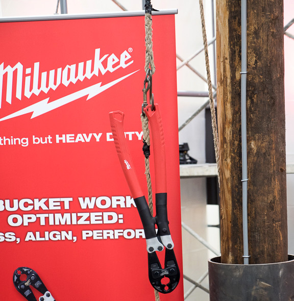 Milwaukee Hand Cable Crimper Hanging from Tool Tether