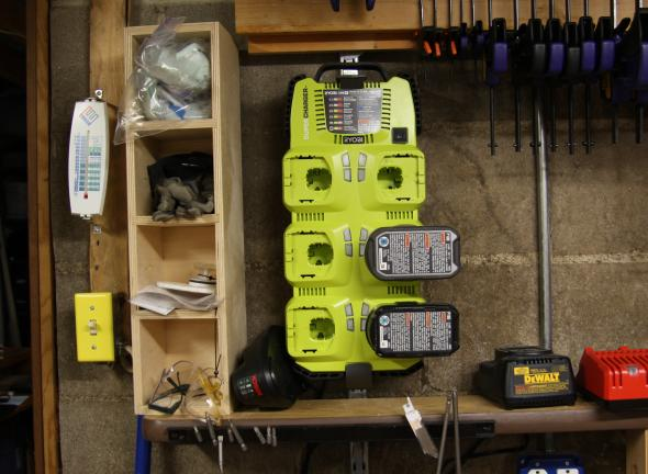 Ryobi multi-charger hanging on the wall