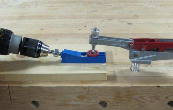 Using a hold down peg clamp to drill pocket holes