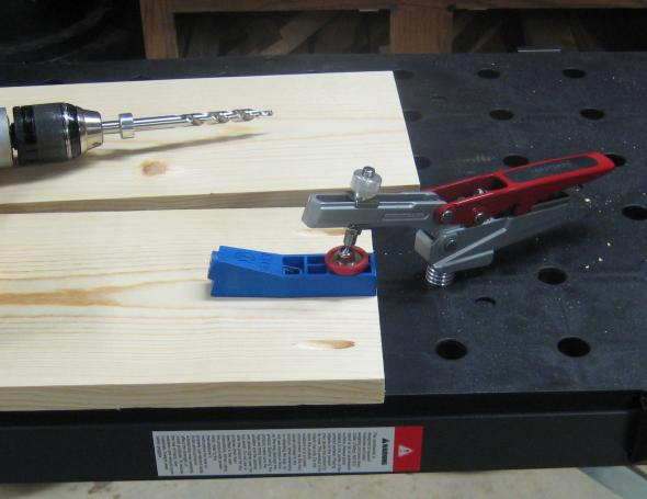 Holding a kreg jig with the peg workbench and hold down clamp