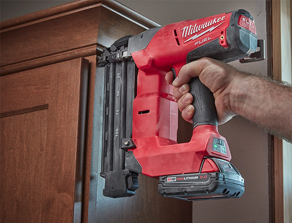 milwaukee m18 fuel cordless brad nailer in use on trim