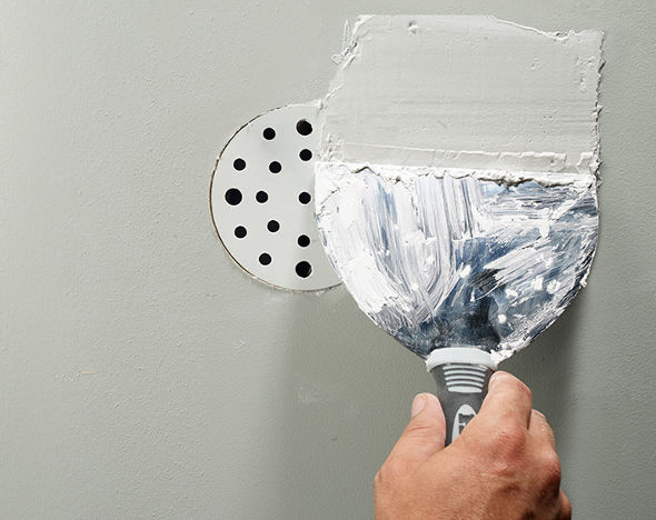 Spackling over the Ryobi drywall repair kit