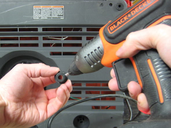 Using the Black and Decker Cordless glue gun to permanently attach the feet of my oscillating sander
