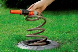 'Hide Your Garden Hose Neatly in the Ground' from the web at 'http://toolguyd.com/blog/wp-content/uploads/2016/05/Gardena-in-ground-sprial-hose-box-installed-from-Amazon-250x167.jpg'
