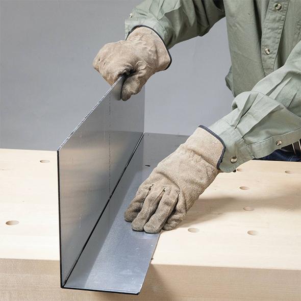 Aluminum Panel Being Bent Along Cut Groove