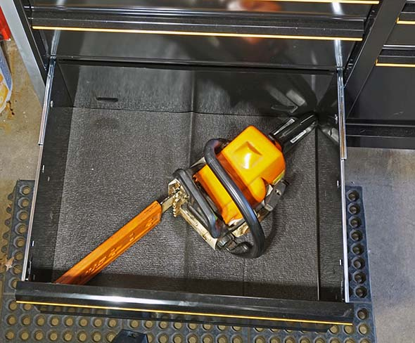 Chainsaw in the Craftsman 41inch Storage Cabinet