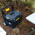Dewalt DS450 Tough System Wheeled Tool Box in the woods after a rain