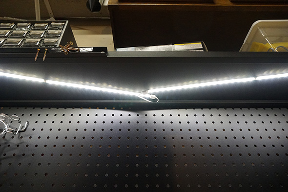 Magnetic LED strip lighting mounted underneath the shelf