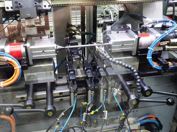 Motor shafts being tested for straightness at Metabo factory in Germany