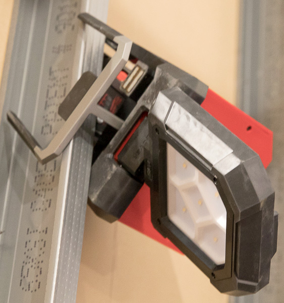 Milwaukee M18 Rover LED Light Clamped to Steel Stud and Aimed Where Needed
