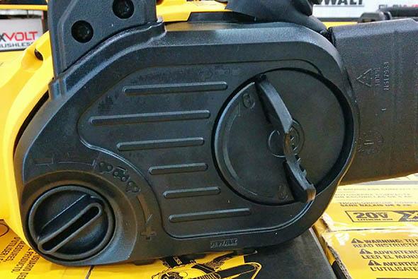 Dewalt 20V compact cordless chainsaw closeup of chain tensioner