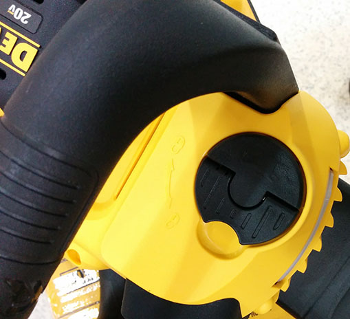 Dewalt 20V compact cordless chainsaw closeup of oil cap