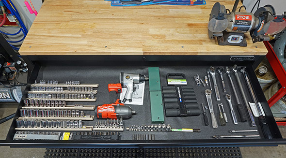 Husky Mobile Workbench with Pegboard Top drawer loaded