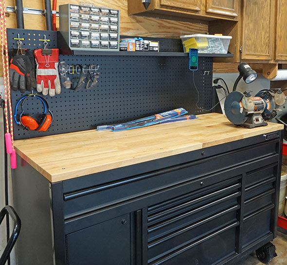 Husky Mobile Workbench with Pegboard in use