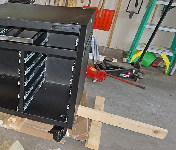 Husky Mobile Workbench with Pegboard installing castors