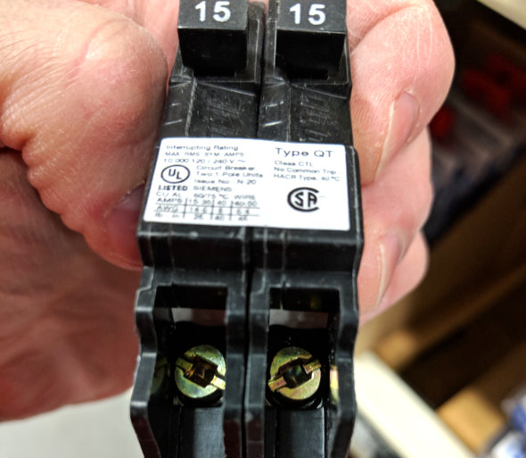 Different type of combination screws on a circuit breaker 2