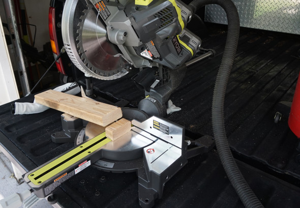 Ryobi One+One cordless sliding miter saw dust collection with vacuum