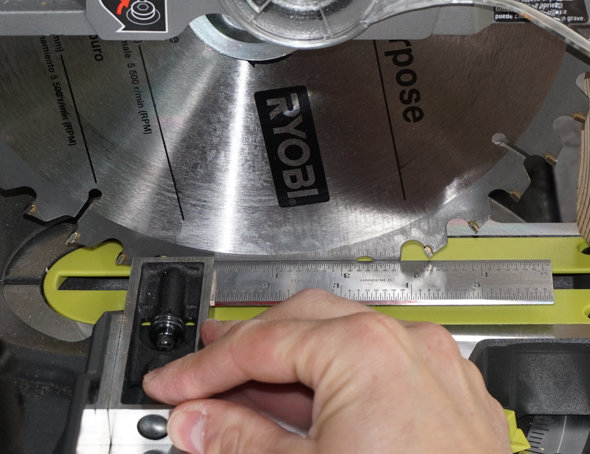 Ryobi One+One cordless sliding miter saw sqaureing the blade to the fence.