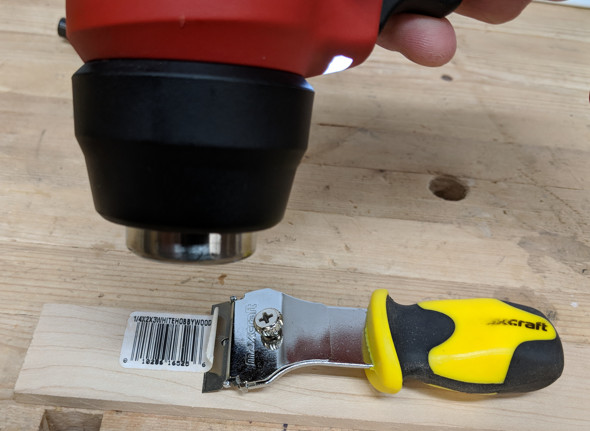 Using the Milwaukee Cordless Heat Gun to Remove a Label