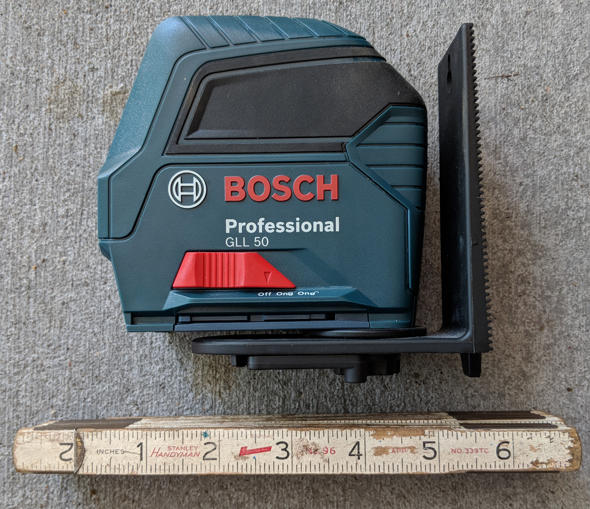 Bosch GLL50 cross line laser level and Stanley Handyman No 96 folding ruler