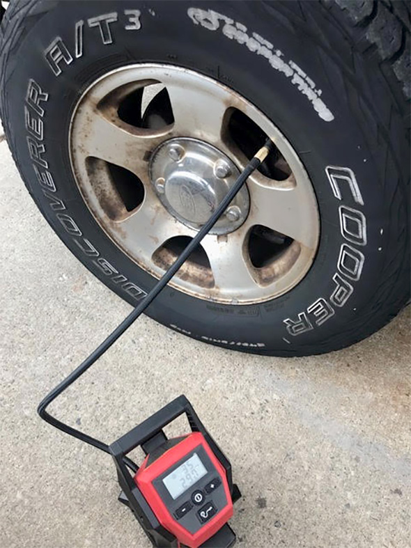 Milwaukee M12 Inflator FIlling Up Tire