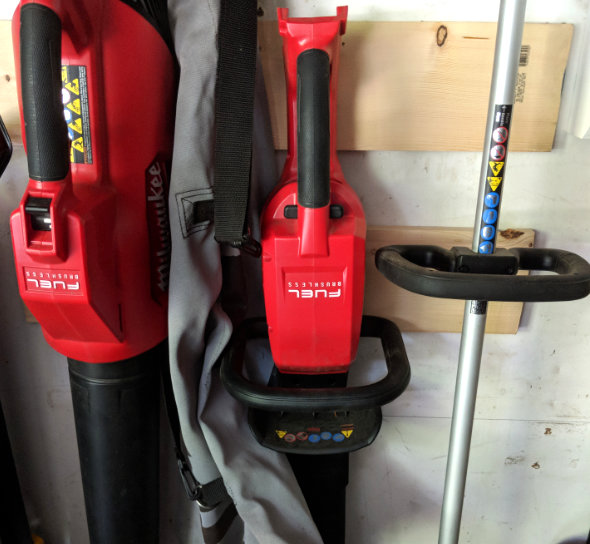 Milwaukee M18 Fuel Hedge Trimmer hanging via keyhole slot