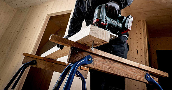 Metabo Cordless Jigsaw Cutting Wood on Folding Sawhorses