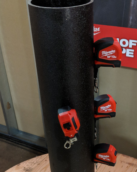 Milwaukee 10 Foot Keychain sticking to a metal pipe