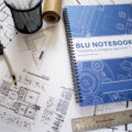 Blu Notebook on Designer Table