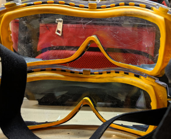 Comparison of old scratched Dewalt goggles and newer protected goggles