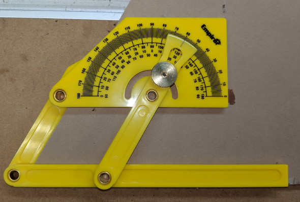 Using the Empire angle finder to double check an angle cut on the miter saw