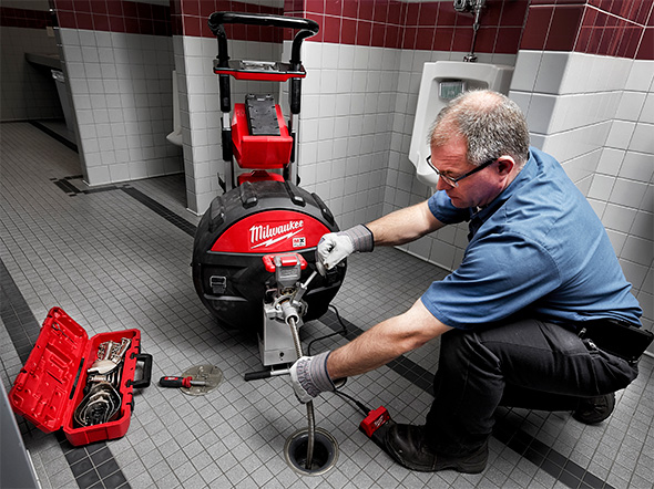 Milwaukee MX Fuel Cordless Drain Cleaner in Action in Commerical Restroom